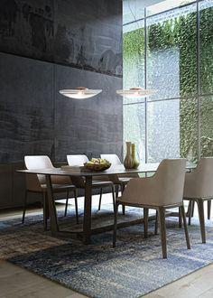 Modern dininrg room ideas | the big window brings so much light to the interiors with an exquisite modern decor |www.bocadolobo.com #diningroomdecorideas #moderndiningrooms