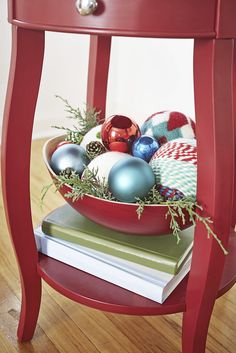 Fill a decorative bowl with extra ornaments and greenery for easy, festive decor to carry you through the holiday season.