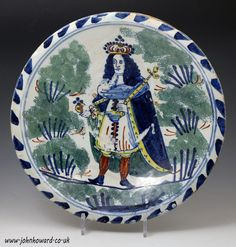 English delftware pottery blue dash delft charger with portrait of King George II 1714 to 1727 Bristol or Brislington England