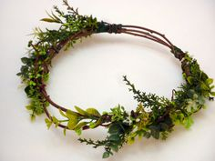 Inspired flower headband,made by many different artificial greenary. For base we used natural branches. We give all our love , we hope you love