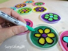 How to make a suncatcher from recycled plastic lids!  Great kids craft! #crafts