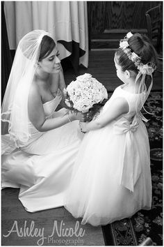 Such a cute photo to have of the bride with her flower girl! Photo by: @ashleynphoto