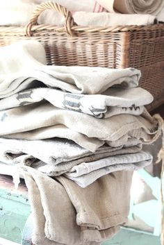 stacks of linens! Jute, Houses In France, Ticking Fabric, Textiles, Grain Sack, Linens And Lace, Wicker, Shabby Chic, Doilies