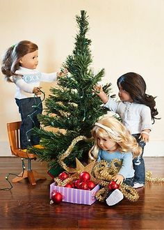 Decorating the tree~have Elfie help the dolls decorate Makenna's tree! Cute American Girl Christmas ideas!