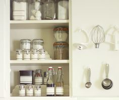 Jenny Steffens Hobick: Baking Pantry in a Cabinet (Love the idea of hanging KA mixer attachments inside the cupboard door.)