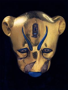 Egypt Leopard-Head Decoration from a Ritual Robe, 18th dynasty, gilded wood, rock  crystal, and colored glass.