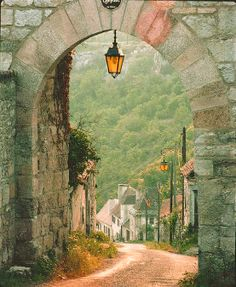 Dordogne ~ France  Love the Wall and road leading around the bend.
