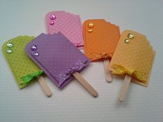 Popsicle embellishments for scrapbooking card making and summer fun. Grape,lemon lime, orange, lemonade and strawberry. Handmade paper piecing scrapbook embellishments from dalayney. chucklesandcharms on etsy.