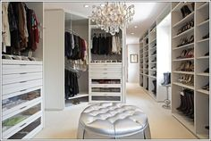 LA Closet Design This closet is all what we call glamour. It has a dazzling white outlook with numerous shelves. This closet has carousels at the corner for your clothes. This closet is provided with laundry center as well. A white chandelier is also available with this closet.
