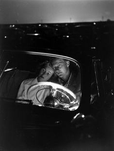 Young Couple Snuggling in Convertible as They Intently Watch Movie at Drive-In Movie Theater, 1949, photo by J R Eyerman [Time Life Pictures/Getty Images] via life: On the 80th anniversary of the first drive-in theater, a series of photos celebrating two abiding American obsessions: cars and movies.