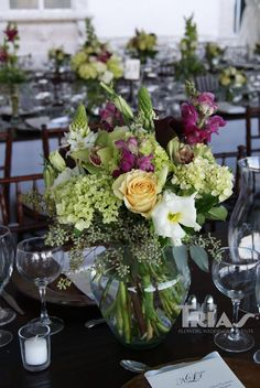 Love this simple green wedding floral arrangement with a pop of color.
