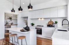 White Kitchen Floor, Classic White Kitchen, Spotted Gum Flooring, Raked Ceiling, White Wood Floors, Kitchen Flooring, Kitchen Wood, Stair Storage, Al Fresco Dining