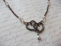 Double hearts with pearls and crystal antique brass necklace de la boutique BijouxdeBrigitte sur Etsy Pendant Necklace, Boutique, Bracelets, Etsy, Jewelry, Antique Brass, Glass Beads, Necklaces, Jewerly
