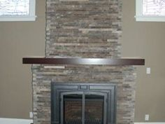 contemporary fireplace using stone veneer