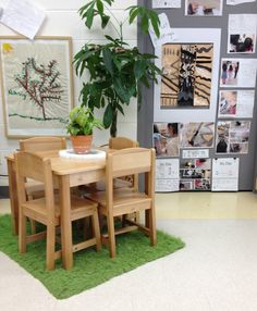 The rug helps to soften and define this snack area while the plants, artwork, and documentation board adds beauty.