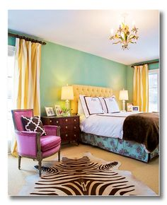Ah ha!  So that's what I can do with all the brown matchy bedroom furniture and that same striped bedding.......great color idea!