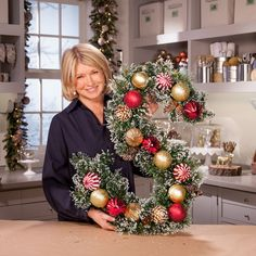 Martha shows you how to make a festive monogram wreath that will add a personal touch to your front door. | Get more step-by-step instructions and how to's from Martha Stewart.