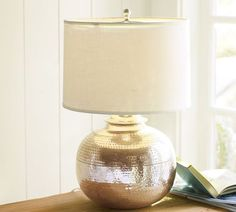 "Small bedside lamp  11.5"" diameter, 14.5"" high  Crafted of brass with an antique-silver finish.  Hand-hammered detailing.  On/off switch on socket  Pair with any of our Small Linen Drum Lamp Shade (sold separately)."