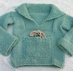 Free Knitting Pattern for Easy Pudding Pie Baby Sweater - Easy pullover baby sweater with pocket in stockinette and seed stitch. Sizes Chest: (22) 26 inches . Note: the toy is not included in the knitting pattern. Also note that this pattern is on the Int