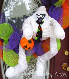 Very cute wreath made with mesh ribbon.  The mummy is made from a gourd and recycled paper towel tubes!  Easy tutorial!