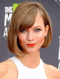 Model Karlie Kloss keeps it classic with her timelessly chic blunt bob. She modernizes the look by giving her bangs a soft sweep and creating a deep side part. For the same bounce and body, apply some light volumizing serum on roots before drying with a round brush, curling under at the ends. via StyleList