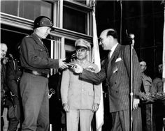 General George S. Patton in Glendale with Lt. General James H. Doolittle and Mayor Albert C. Lane, June 10, 1945. Mayor Lane presents Patton with the Freedom of the City plaque. San Fernando Valley History Digital Library.