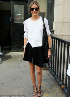 So stylish! Olivia Palermo stepped out in a chic black skirt and fringed bag as she stepped out of the Prabal Gurung Fashion Show in New York City on Saturday 299 58 1