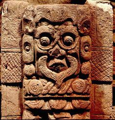 Carved stone depiction of the Jaguar God of the Underworld, from a stele at Copan, Honduras. Probably 7th century.