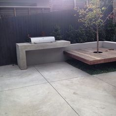 #concrete BBQ bench and house surround after shot.