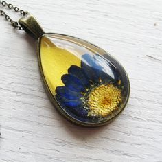Real Pressed Flower Necklace - Yellow and Blue Daisy Botanical Teardrop Necklace by wintergardenstudios on Etsy