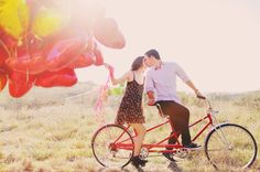red heart balloon  and tandem bicycle engagement