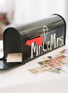 Gift Table Idea- people write Messages on postcards and leave them in the mailbox