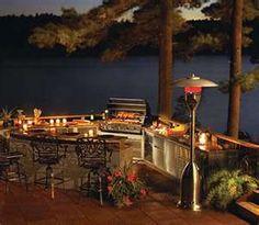 outdoor kitchen overlooking water. yes please!