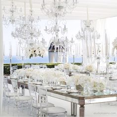 A tented white garden wedding looks stunning with a ceiling full of chandeliers