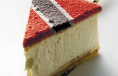 SLICE OF TNT CAKE   I just wanted to give you a bit of a close up of the cake. Most people think the colours were put on at the cake shop. The truth is this was a stock image of a plain cake and I put the Trinidad & Tobago national coloured frosting on in photoshop.