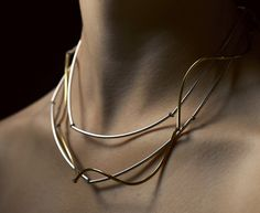 Linda van Niekerk  Neckpiece: Silver Clouds, Golden Storm 2013  Sterling silver, 22ct Gold plated onto sterling silver, silk  Image : Peter Whyte  (shown here wrapped around neck)  Please Note: All long neckpieces in the Clouds series can be worn in 5 different ways. For details see website.