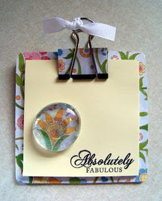 Coaster, post it note, and binder clip. Great gift idea!