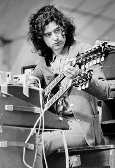 Jimmy Page tunes his guitar