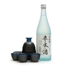 A traditional Japanese sake set, including one tokkuri dispenser, four ochoko cups, and one bottle of Gekkeikan junmai sake, or pure rice wine.