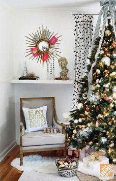 A Perfectly Festive Living Room: Christmas tree, sunburst mirror for holiday cards, and the Home Decorators Marie armchair!