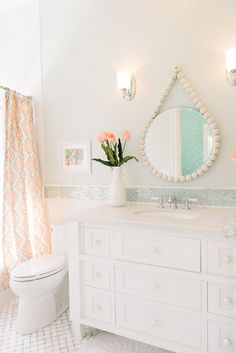 Love this bathroom. Especially that mirror. - House of Turquoise: Dream Home Tour - Day Three Little Girl Bathrooms, Bathroom Kids, Mirror Bathroom, Bathroom Shop, Girl Bathroom Ideas, White Bathroom, Wall Mirror, Bright Bathrooms, Pastel Bathroom