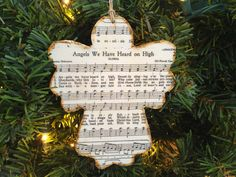 Christmas Music Ornaments, Christmas Hymn Ornaments, Sheet Music Ornaments, Rustic Ornaments, Wooden Ornaments, Angel Ornaments by AtHomeWithWords on Etsy https://www.etsy.com/listing/477492644/christmas-music-ornaments-christmas-hymn