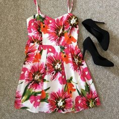 Bright floral summer dress Great for a sunny summer wedding or day out. Sweetheart neckline with spaghetti straps. Adjustable straps. Hidden zipper down the back. Bow (fourth photo) can be tied in the front or back. From top hem of the back down to bottom hem of the skirt is about 22 inches. From the highest part of the neckline down to the hem of the skirt on the front is about 26 inches. Forever 21 Dresses Mini