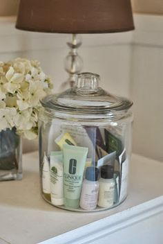 Jar of cosmetic samples for guests. Guest room organization!