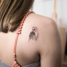 watercolor owl tattoo on the shoulder