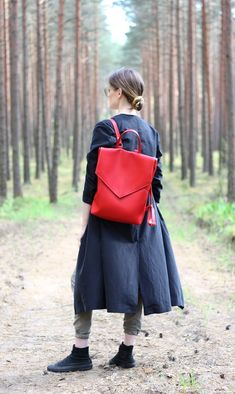 This red backpack is a perfect everyday accessory! Minimalistic design, but eye catching color. :) Handmade vegan leather backpack with cotton interior lining and one interior pocket. This backpack is made to order. Lead time is currently about 3 - 5 business / working days (not including