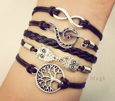 A cute multi-wrap bracelet featuring gorgeous tree of life, owl, music and infinity charms