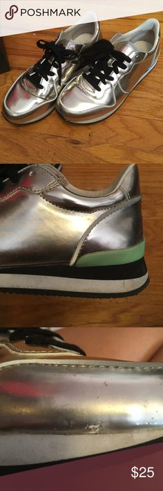 Silver Sneakers Loved the look of these. There have been worn a few times but still in good condition. There is a small mark on the last picture. Please note that the sneakers are stiff. Comes with box Steve Madden Shoes Sneakers