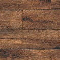 Vinyl Flooring.  Armstrong.  Rustic Timber:  Brown.  Approx. $18.00 square yard.  http://www.discountfloor.com/item_245858/Vinyl/Armstrong_Vinyl_Floors/CushionStep_Best/Rustic_Timbers/Brown.php