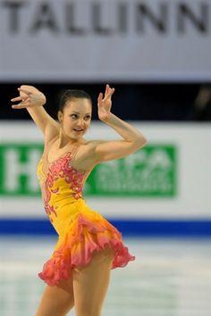 Sarah Meier, Orange Coral Skating / Ice Skating dress inspiration for Sk8 Gr8 Designs.